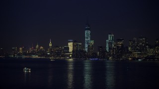 AX65_0288 - 5K stock footage aerial video of the skyline of Lower Manhattan and Freedom Tower, New York City, winter, night