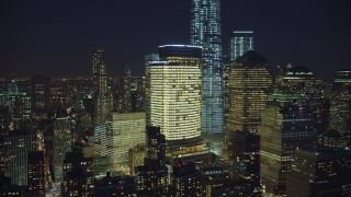 AX65_0291 - 5K stock footage aerial video of flying past World Trade Center skyscrapers and Freedom Tower in Lower Manhattan, NYC, winter, night