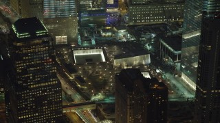 AX65_0294 - 5K stock footage aerial video of the World Trade Center Memorial in Lower Manhattan, New York City, winter, night