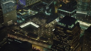 AX65_0295 - 5K stock footage aerial video of passing by the World Trade Center Memorial in Lower Manhattan, New York City, winter, night