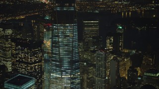 AX65_0298 - 5K stock footage aerial video orbit and tilt to the top of One World Trade Center skyscraper in Lower Manhattan, New York City, winter, night