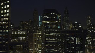 AX65_0301 - 5K stock footage aerial video of flying by tall riverfront skyscrapers in Lower Manhattan, New York City, winter, night
