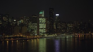 AX65_0306 - 5K stock footage aerial video approach the United Nations building in Midtown Manhattan, New York City, winter, night