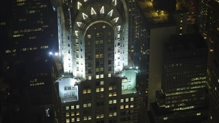 AX65_0318 - Aerial stock footage of An orbit of the Chrysler Building in Midtown Manhattan, New York City, winter, night