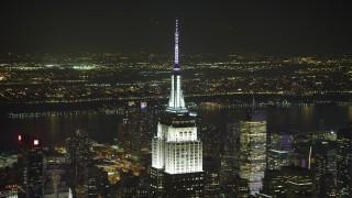AX65_0323 - 5K stock footage aerial video orbit the Empire State Building in Midtown Manhattan, New York City, winter, night