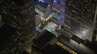 AX65_0333 - 5K stock footage aerial video orbit Rockefeller Center ice skating rink, Midtown Manhattan, New York City, winter, night