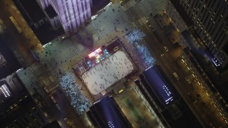 AX65_0338 - 5K stock footage aerial video of a bird's eye view of the Rockefeller Center ice skating rink, Midtown Manhattan, New York City, winter, night