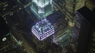AX65_0342 - 5K stock footage aerial video of an orbit of the Helmsley Building in Midtown Manhattan, New York City, winter, night