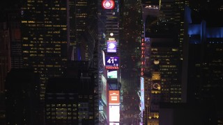 AX65_0346 - Aerial stock footage of Approach the large screens and 2014 New Years ball at Times Square, New York City, winter, night