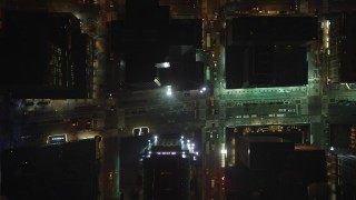 AX65_0353 - 5K stock footage aerial video of bird's eye view of Broadway and 7th Avenue in Midtown Manhattan, New York City, winter, night