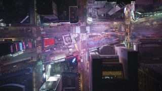 AX65_0356 - Aerial stock footage of Bird's eye of Broadway and 7th Avenue, Times Square in Midtown Manhattan, New York City, winter, night