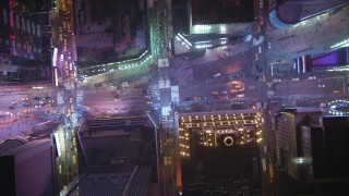 AX65_0357 - Aerial stock footage of A bird's eye of Broadway and 7th Avenue intersection in Times Square in Midtown Manhattan, New York City, winter, night