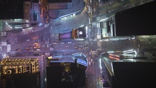 AX65_0358 - Aerial stock footage of Bird's eye of Broadway, 7th Avenue and cross streets in Times Square, Midtown Manhattan, New York City, winter, night