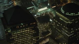 AX65_0381 - 5K stock footage aerial video flyby Three World Financial Center to reveal the World Trade Center Memorial in Lower Manhattan, New York City, winter, night