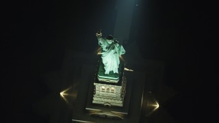 AX65_0395 - 5K stock footage aerial video tilt to a bird's eye view of the Statue of Liberty in New York, winter, night