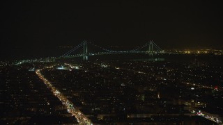 AX65_0396 - 5K stock footage aerial video of Verrazano-Narrows Bridge seen from Brooklyn neighborhoods in New York City, winter, night