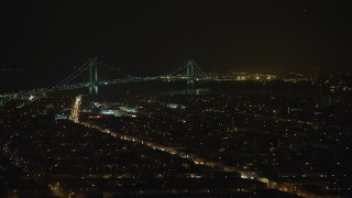 AX65_0397 - 5K stock footage aerial video of a view of the Verrazano-Narrows Bridge from Brooklyn neighborhoods in New York City, winter, night
