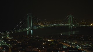 AX65_0398 - 5K stock footage aerial video flyby the Verrazano-Narrows Bridge in New York City, winter, night