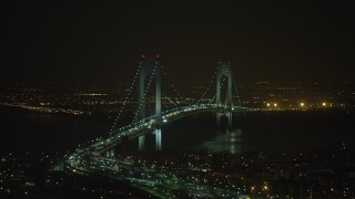 AX65_0399 - 5K stock footage aerial video of passing by the Verrazano-Narrows Bridge in New York City, winter, night