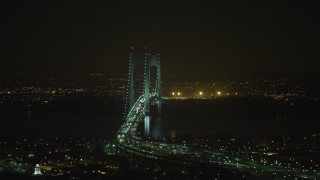 AX65_0400 - 5K stock footage aerial video of light traffic on the Verrazano-Narrows Bridge in New York City, winter, night