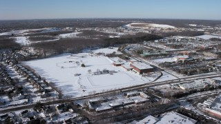 AX66_0003 - 5K stock footage aerial video of a snow covered sports field at the State University of New York at Farmingdale, Long Island