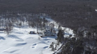 AX66_0017 - 5K stock footage aerial video of a snow covered mansion, Jericho, New York