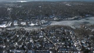AX66_0031 - 5K stock footage aerial video of snow covered neighborhoods on Manhasset Bay, New York