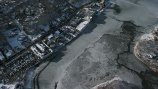 AX66_0032 - 5K stock footage aerial video of ice covered Manhasset Bay in New York