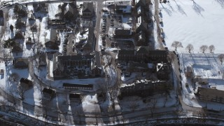 AX66_0038 - 5K stock footage aerial video of a bird's eye view of a military base in snow, Fort Totten, New York