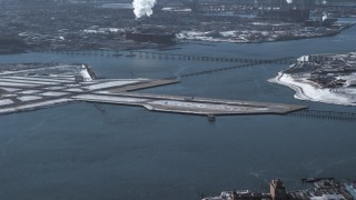 AX66_0044 - 5K stock footage aerial video of an airliner landing at LaGuardia Airport, New York
