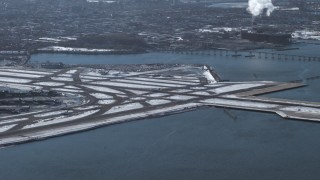 AX66_0045 - 5K stock footage aerial video of a jet landing at LaGuardia Airport, New York