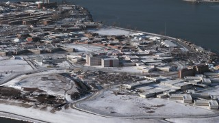 AX66_0048 - 5K stock footage aerial video of prison buildings on Rikers Island in snow New York