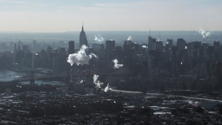 AX66_0051 - 5K stock footage aerial video of smoke stacks and skyscrapers in Midtown Manhattan, New York