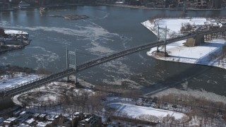 AX66_0053 - 5K stock footage aerial video of Robert F Kennedy Bridge and icy Harlem River, New York