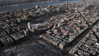 AX66_0059 - 5K stock footage aerial video tilt from Central Park to reveal Columbia University with snow, New York City