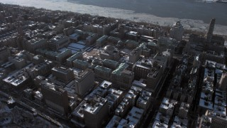AX66_0062 - 5K stock footage aerial video orbit the Columbia University campus with snow, New York City