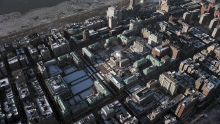 AX66_0064 - 5K stock footage aerial video orbit and fly away from Columbia University with snow, New York City