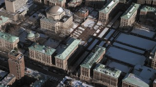 AX66_0066 - 5K stock footage aerial video orbit the Columbia University campus and library with snow, New York City