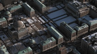 AX66_0067 - 5K stock footage aerial video of library on Columbia University campus with snow, New York City