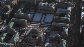 AX66_0068 - 5K stock footage aerial video orbit library and snowy grounds of the Columbia University campus, New York City