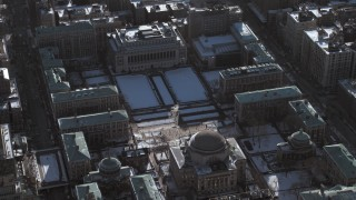 AX66_0069 - 5K stock footage aerial video of circling the library and snow covered grounds at Columbia University,  New York City