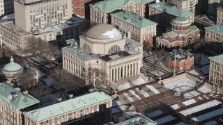AX66_0073 - 5K stock footage aerial video of Low Memorial Library at Columbia University with snow, New York City