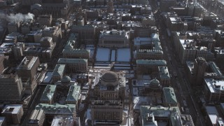AX66_0076 - 5K stock footage aerial video orbit around the Columbia University campus with snow, New York City