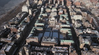 AX66_0080 - 5K stock footage aerial video of circling around the Columbia University campus with snow, Morningside Heights, New York City