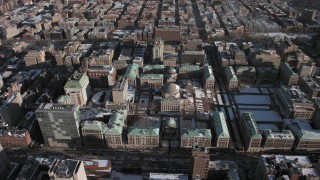 AX66_0082 - 5K stock footage aerial video of orbiting the snowy campus of Columbia University, Morningside Heights, New York City