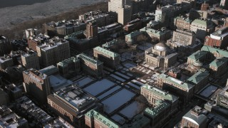 AX66_0094 - 5K stock footage aerial video of Columbia University campus with snow, New York City