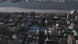 AX66_0095 - 5K stock footage aerial video of the snowy Columbia University campus in New York City