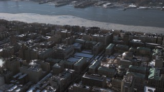 AX66_0096 - 5K stock footage aerial video of circling around the Columbia University campus with snow, Morningside Heights, New York City