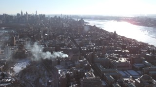 AX66_0097 - 5K stock footage aerial video orbit Columbia University campus and tilt to reveal Midtown, New York City