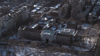 AX66_0106 - 5K stock footage aerial video of Museum of Natural History with snow, New York City